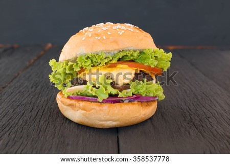 Closeup of home made burgers on black background - stock photo