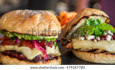 Closeup of home made burgers with the fries potato on wooden and linen background