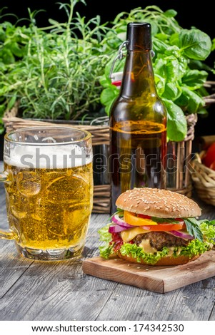 Closeup of homemade burger and a cold beer