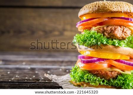 Closeup of homemade double-decker burger - stock photo