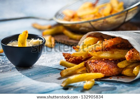 Closeup of homemade Fish & Chips and sauce - stock photo
