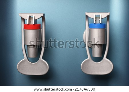 closeup of hot and cold faucet of water dispenser - stock photo