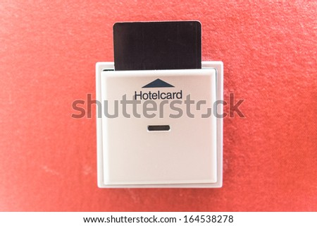 Closeup of hotel room door and lights electronic card in the wall - stock photo