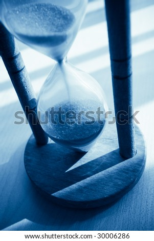 closeup of hourglass blue toned - stock photo