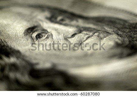 Closeup of hundred dollar bill isolated on white background - stock photo
