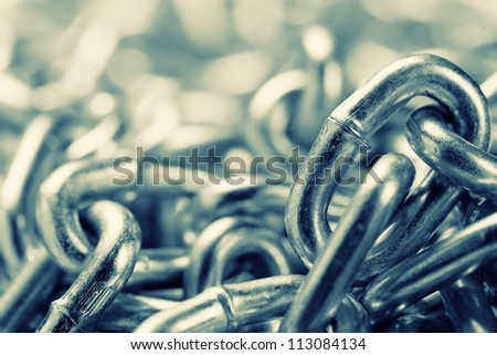 Closeup of industrial chains. Toned - stock photo