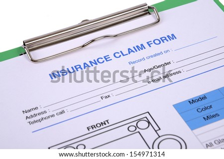 Closeup of insurance claim form on clipboard.