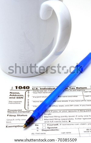 Closeup of IRS form 1040 on white background. - stock photo