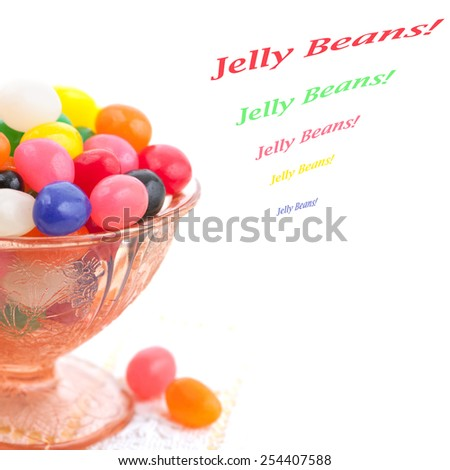 Closeup of Jelly Beans in Depression Ware Glass Bowl on white lace tablecloth on white background.  Square crop, isolated with room or space for copy, text, your words. Celebrate a Kid's Party!  - stock photo