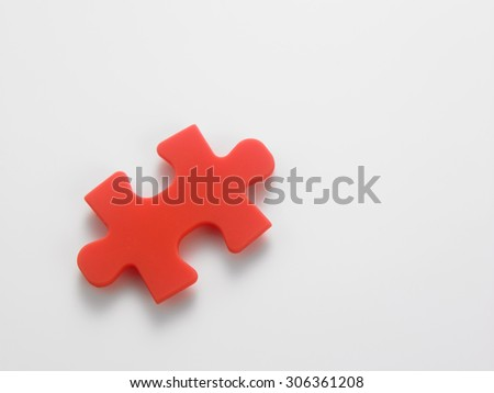 Closeup of jigsaw puzzle piece isolated on white
