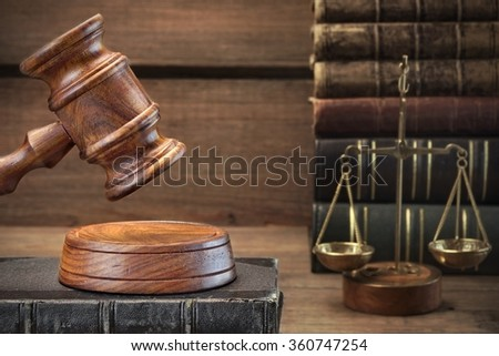 Closeup Of Judges Gavel, Legal Code, Scales Of Justice On The Rough Wooden Background. Law Concept - stock photo