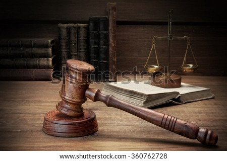 Closeup Of Judges Or Auctioneer Gavel, Legal Code, Scales Of Justice On The Rough Wooden Background. Law Concept - stock photo
