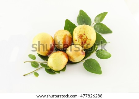 closeup of Jujube with leaves on white background