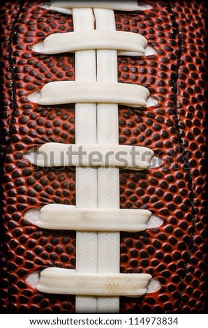 Closeup of laces on American football.