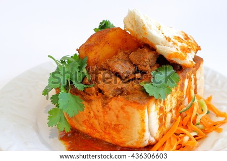 "Closeup of lamb ""bunny chow"" - the popular, Indian fast food cuisine which originated in South Africa"