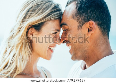 Closeup of Laughing Couple Touching Foreheads