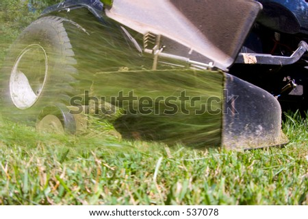 Closeup of lawnmower - stock photo