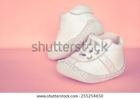 Closeup of leather baby shoes - stock photo