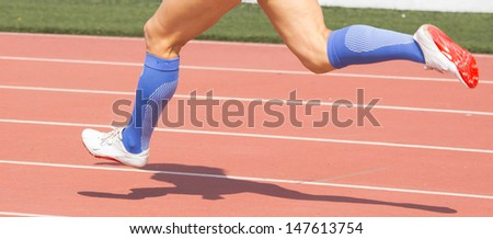 Closeup of legs of a track runner