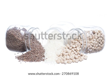 Closeup of legumes jar spilled isolated on white background - stock photo