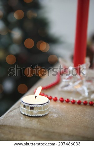 Closeup of lit tealight candles during Christmas