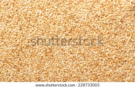 Closeup of lots of toasted sesame seeds