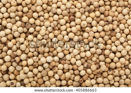 Closeup of lots of white peppercorns