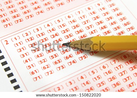 closeup of lottery ticket and pencil - stock photo