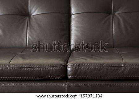 Closeup of luxurious expensive brown leather couch - stock photo