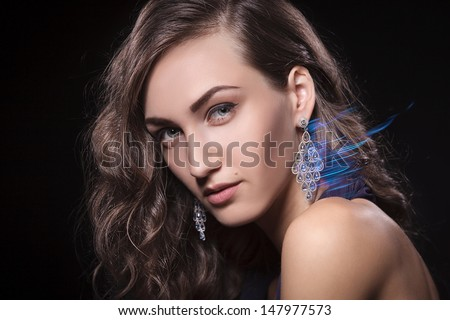 Closeup of luxury woman wearing diamond earrings