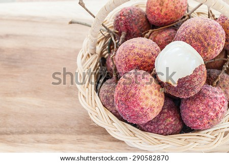 Closeup of lychee fruit in basket, fruit of Asia. - stock photo