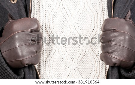 Closeup of macro design of knitted sweater and jacket of male winter clothes