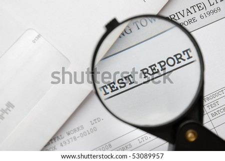 Closeup of magnifying glass on test report. For research and laboratory, science and technology, or medical concepts. - stock photo