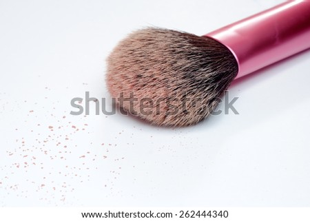 Closeup of makeup brush and blush on white background - stock photo
