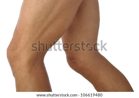 Closeup of male athletes lean muscular legs on white background - stock photo
