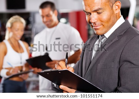 closeup of male gym manager - stock photo