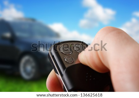Closeup of male hand holding remote control car key - stock photo