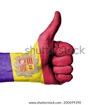 Closeup of male hand showing thumbs up sign against white background, Andorra - stock photo