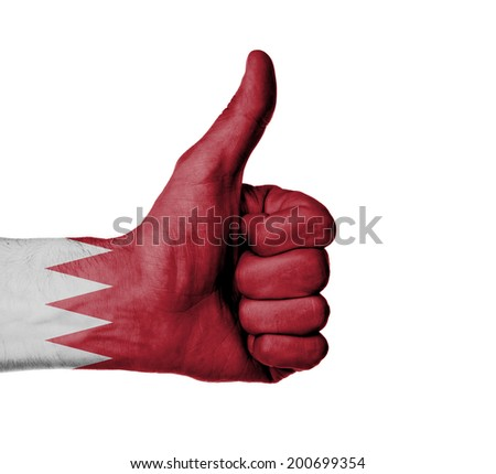 Closeup of male hand showing thumbs up sign against white background, Bahrain - stock photo