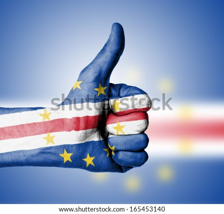 Closeup of male hand showing thumbs up sign, flag of Cape Verde - stock photo
