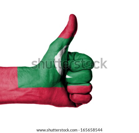 Closeup of male hand showing thumbs up sign, flag of Maldives - stock photo