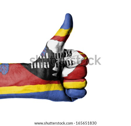Closeup of male hand showing thumbs up sign, flag of Swaziland - stock photo