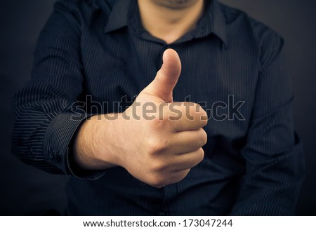 Closeup of man hand showing thumbs up - stock photo