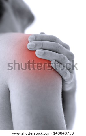 Closeup of man holding his painful injured shoulder. Over white background.