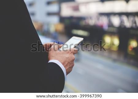 Closeup of man`s hands is holding cellphone with empty copy space screen for your advertising text message or promotional content. Closely of businessman search information in network via smart phone - stock photo