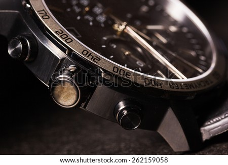 Closeup of man watch on a black background - stock photo