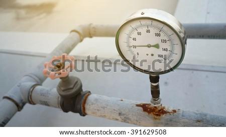 Closeup of manometer, measuring water pressure. - stock photo