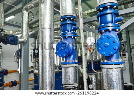 Closeup of manometer, pipes and faucet valves of gas heating system in a boiler room - stock photo