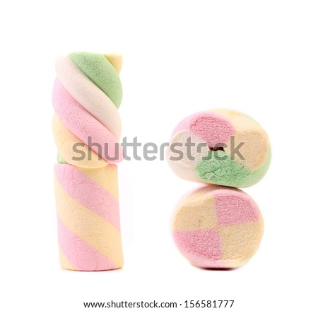 Closeup of many-colored marshmallows. Isolated on a white background.