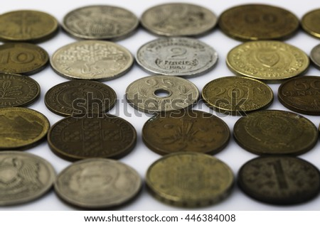 Closeup of many old coins on white background - stock photo